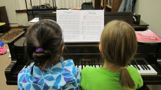 two-girls-at-piano